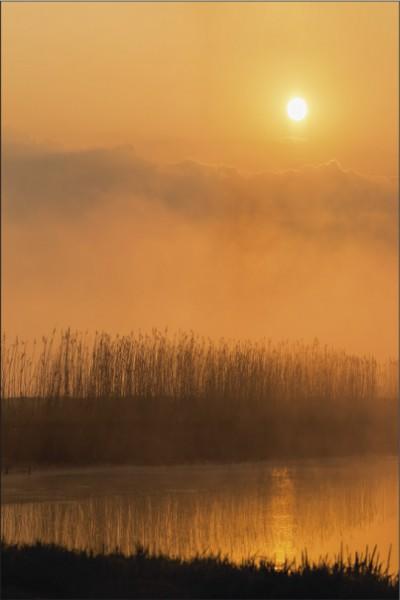 Sonnenaufgang über dem Wasser 2